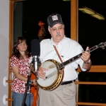 Kelly Stockwell backing up some old-timer (Dick Bowden) on banjo