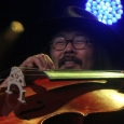 Joe Kwon with The Avett Brothers at MerleFest 2013 - photo by Andy Garrigue