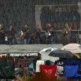 Larry Cordle & Lonesome Standard Time brave the deluge at Red, White & Bluegrass 2013 - photo by Bill Warren