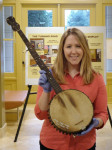 Annmarie Reiley-Kay, curator of the Earl Scruggs Center, with a banjo that had belonged to SCruggs's grandfather
