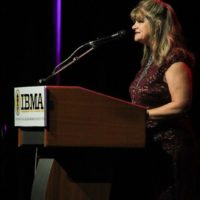 Cindy Baucom accepting the 2017 Broadcaster of the Year Award from the IBMA - photo by Frank Baker