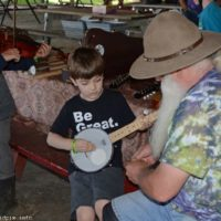 A new banjo picker at the 2019 Charlotte Bluegrass Festival - photo © Bill Warren